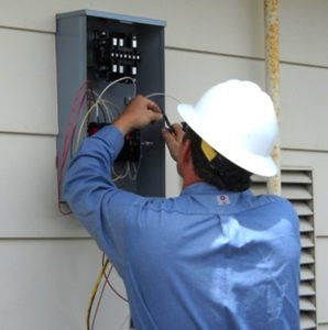 Electrician Installing Sub Panel and Breakers
